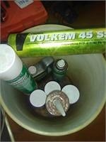 Bucket of home repair sprays and sealants.