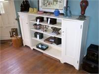 Bookshelf with storage cabinets on side,