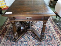 Walnut based table with pull out extension ends,
