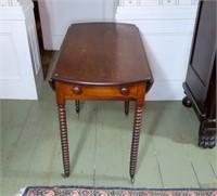 Round walnut drop leaf table with drawer,