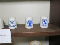 Assorted German Steins and glasware, on shelf