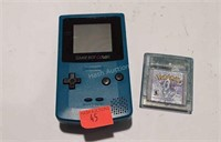 Nintendo Game boy color, with pokemon game.