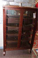 Oak glass front Curio Cabinet on Casters