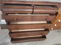 Wooden dresser with six drawers on wheels