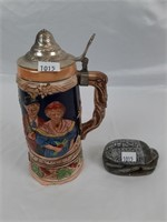 African carvings and beer stein