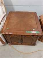 Wooden side table with doors and hexagonal side