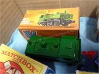 9 die-cast Matchbox vehicles - MIB - PLUS 1 empty