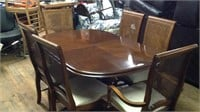 Dining room table with six chairs and leaf