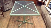 Metal outdoor table with glass top
