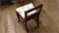 Small wooden chair with storage compartment