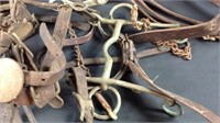 Big pile of old horse tack bits holsters etc.
