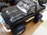 R/C - black Toyota pick-up truck w/ 2 controllers