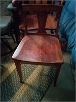 2 wooden chairs in basement