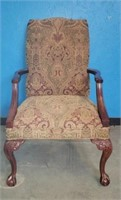 Hand carved upholstered arm chair