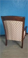 Wooden upholstered arm chair