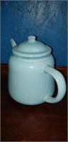 Light blue enamelware tea pot