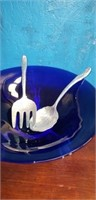 Blue bowl with rabbit legs and spoon fork