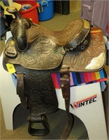 15 LONG HORN #1974 ROPING SADDLE WITH SILVER TRIM.