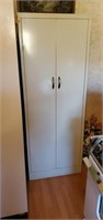 White metal cabinet Approx size is 65 inches tall