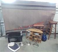 Area rug, stool, lamps, microwave, wood decor