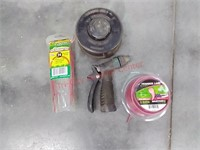 32 gal. Trash can, hose reel, yard supplies