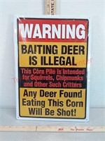 Baiting deer metal novelty sign