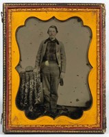 Rare half-plate ambrotype of a young man with kepi, probably a Confederate soldier wearing a home-made uniform