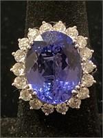 PLATINUM LARGE TANZANITE AND DIAMOND RING