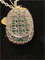PLATINUM OVER SILVER, 101 CT BERYL EMERALD AND