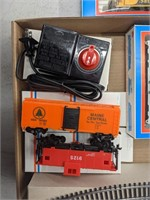 Group of HO scale model trains, tracks, and