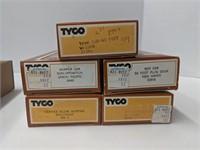 Five Tyco HO scale model trains.