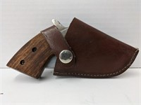 Stainless steel Gun-knife with leather holster.