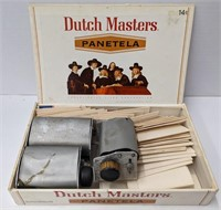Vtg rolling papers and three cigarette rollers.