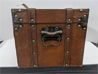 Wooden chest with leather straps and metal