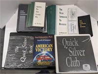 Group of self help/financial advice tapes, books,