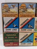 Nine EMPTY shotgun shell boxes.