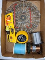 Group of assorted fishing equipment. Line,