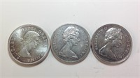 Three Canadian silver dollars