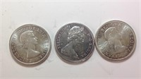 Three Canadian silver dollars