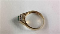 14 K gold emerald and diamond ring