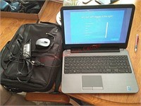 Dell laptop computer- turns on w/mouse, cord, case