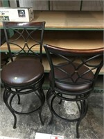 Two high top swivel chairs