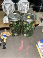 2 jars full of marbles