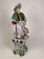 Figure of Woman walking dog