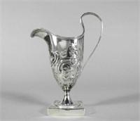 Several silver pieces, including Hester Bateman