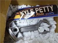 Richard Petty uniform & piston (signed)