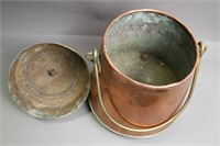 BRASS AND COPPER FOOTED POT WITH LID 10X14X10