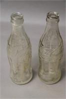 TWO GLASS COKE BOTTLES
