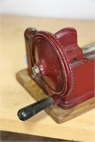 CAST EARLY PENCIL SHARPENER MOUNTED ON WOOD