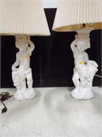 Pair of cherub lamps
